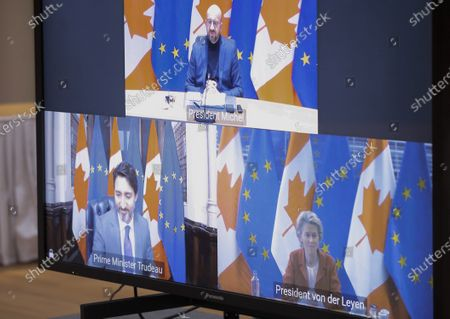 European Council President Charles Michel, top, speaks to Canadian Prime Minister Justin Trudeau, bottom left, and European Commission President Ursula von der Leyen, bottom right, via video link during an EU-Canada summit at the European Council building in Brussels, . Leaders are expected to discuss the COVID-19 pandemic, economic recovery and bilateral relations, as well as global and regional issues
