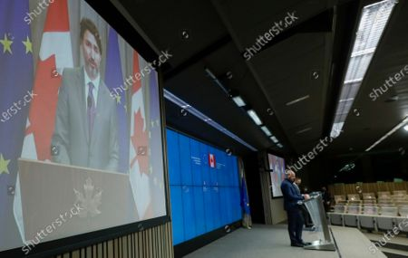 European Council President Charles Michel and Canadian Prime Minister Justin Trudeau participate in a video linked media conference after an EU-Canada summit via video conference at the European Council building in Brussels, . Leaders are expected to discuss the COVID-19 pandemic, economic recovery and bilateral relations, as well as global and regional issues