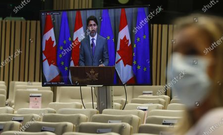 Canadian Prime Minister Justin Trudeau, on screen, participates in a video linked media conference after an EU-Canada summit via video conference at the European Council building in Brussels, . Leaders are expected to discuss the COVID-19 pandemic, economic recovery and bilateral relations, as well as global and regional issues