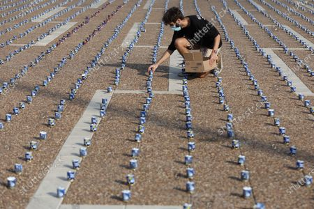 An Israeli worker places 25,000 memorial candles for the 25th anniversary of the assassination of the late Israeli PM, Yitzhak Rabin in Rabin Square, Tel Aviv,  Israel, 29 October 2020. Rabin received the Nobel Prize for Peace in 1994 along with his Foreign Minister Shimon Peres and Palestine Liberation Organization leader Yasser Arafat, for their efforts towards peace. He was the fifth Prime Minister of Israel, serving two terms in office, 1974-77, and 1992 until his assassination in 1995. Rabin was fatally shot after attending a peace rally held in Tel Aviv's Kings Square by a far-right Jewish law student, on 04 November 1995.