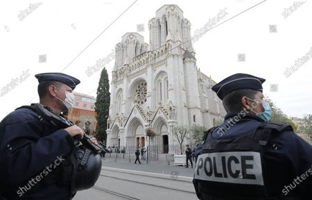 Police officers stand guard at the scene of a reported knife attack at Notre Dame church in Nice, France, October 29, 2020.