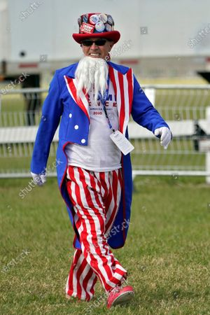 Will Enderly, dressed as Uncle Sam, arrives for a campaign rally by President Donald Trump, in Tampa, Fla
