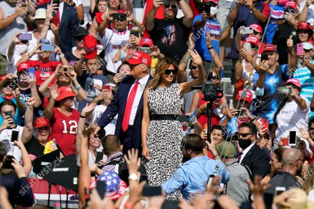 President Donald Trump and first lady Melania Trump arrive for a campaign rally, in Tampa, Fla