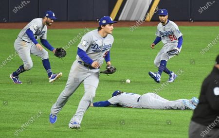 Stock Image of ARLINGTON, TEXAS OCTOBER 24, 2020-A broken bat single by Rays Kevin Kiermaier falls between Dodgers from left, Chris Taylor, Corey Seager, Kiki Henadez and Mookie Betts in the 9th inning in Game 4 of the World Series at Globe Life Field in Arlington, Texas Saturday. (Wally Skalij/Los Angeles Times)