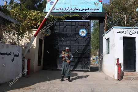 An Afghan security official stands guard outside the prison after a riot in Herat, Afghanistan, 29 October 2020. Eight more inmates and four security guards were injured in the rioting that took place on 29 October evening after jail authorities tried to seize prohibited items and tools, such as knives and phones, smuggled into the jail.