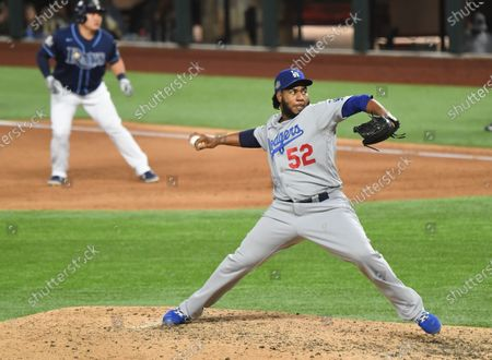 Dodgers relief pitcher Pedro Baez throws a pitch against the Rays in the 8th inning in Game 4 of the World Series at Globe Life Field in Arlington, Texas Saturday. (Wally Skalij/Los Angeles Times)