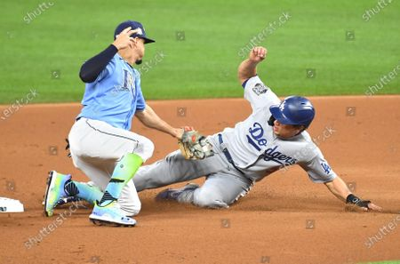 Dodgers Corey Seager beats the tag from Rays shortstop Willy Adames in the 1st inning in Game 5 of the World Series at Globe Life Field in Arlington, Texas Sunday. (Wally Skalij/Los Angeles Times)