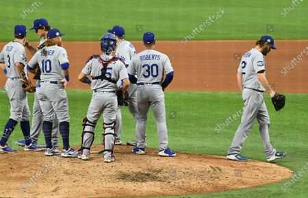 Dodgers manager Dave Roberts takes pitcher Clayton Kershaw out of the game inthe 6th inning against the Rays in Game 5 of the World Series at Globe Life Field in Arlington, Texas Sunday. (Wally Skalij/Los Angeles Times)