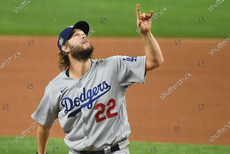 Dodgers pitcher Clayton Kershaw points to the sky as a Rays hitter pops-up in the 6th inning in Game 5 of the World Series at Globe Life Field in Arlington, Texas Sunday. (Wally Skalij/Los Angeles Times)