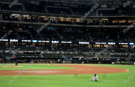Dodgers starting pitcher Clayton Kershaw sits alone before Game 5 of the World Series at Globe Life Field in Arlington, Texas Sunday. (Wally Skalij/Los Angeles Times)