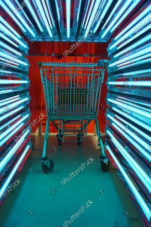 A device using ultraviolet light to sterilize shopping carts, Hamburg, Germany