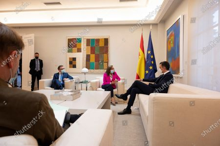 A handout photo made available by Spanish goverment shows Spanish Prime Minister Pedro Sanchez (R) during his meeting with Ibero-American Secretary General Rebeca Grynspan (2-R) at La Moncloa Palace, Madrid, 29 October 2020.