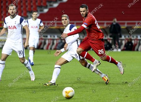 Royal Antwerp's Jeremy Gelin, right, vies for the ball against Tottenham's Erik Lamela, second right, during the Europa League Group J soccer match between Antwerp and Tottenham at the Bosuil stadium in Antwerp, Belgium