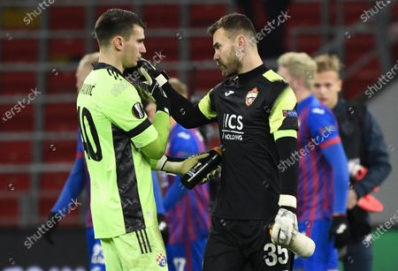 Zagreb's goalkeeper Dominik Livakovic (L) and CSKA Moscow's goalkeeper Igor Akinfeev (R) react after the UEFA Europa League group K soccer match between CSKA Moscow and Dinamo Zagreb in Moscow, Russia, 29 October 2020.