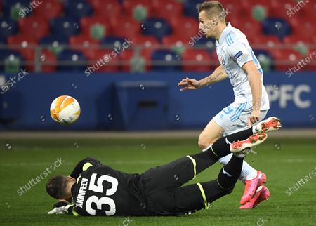 CSKA Moscow's goalkeeper Igor Akinfeev (L) in action against Mislav Orsic (R) of Zagreb during the UEFA Europa League group K soccer match between CSKA Moscow and Dinamo Zagreb in Moscow, Russia, 29 October 2020.