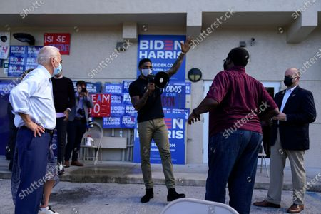 Miami Heat player Udonis Haslem speaks as Democratic presidential candidate former Vice President Joe Biden appears outside a campaign victory center, in Fort Lauderdale, Fla