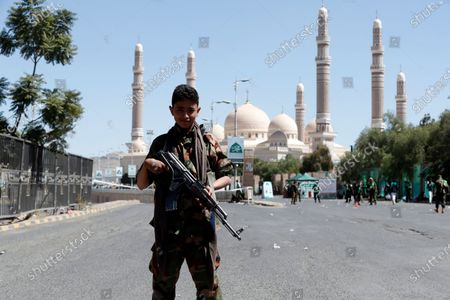 A Yemeni soldier stands guard during a Mawlid celebration, which marks the birth anniversary of Muslims' Prophet Muhammad, at a square in Sana'a, Yemen, 29 October 2020. Thousands of Yemenis attended the Mawlid celebration at al-Sabaeen square in Sana'a to commemorate the birth anniversary of Muslims Prophet Muhammad, at an event organized by the Houthis.