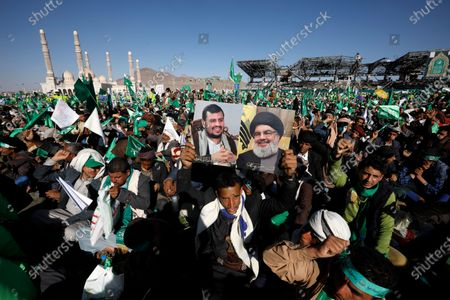 A Yemeni holds a poster of (R-L) Lebanon's Hezbollah chief Hassan Nasrallah and Shiite Houthi movement's leader Abdul-Malik al-Houthi during a Mawlid celebration, which marks the birth anniversary of Muslims' Prophet Muhammad, at a square in Sana'a, Yemen, 29 October 2020. Thousands of Yemenis attended the Mawlid celebration at al-Sabaeen square in Sana'a to commemorate the birth anniversary of Muslims Prophet Muhammad, at an event organized by the Houthis.