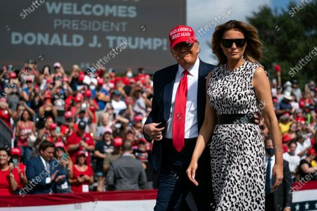President Donald Trump and first lady Melania Trump arrive for a campaign rally outside Raymond James Stadium, in Tampa