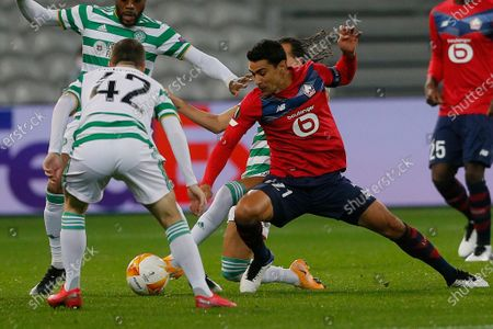 Lille's Benjamin Andre, right, fights for the ball with Celtic's Callum McGregor during the Europa League Group H soccer match between Lille and Celtic Glasgow at the Stade Pierre Mauroy stadium in Villeneuve d'Ascq, northern France