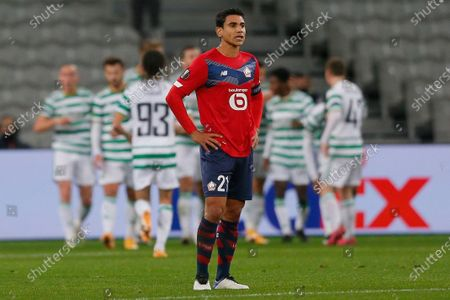 Lille's Benjamin Andre reacts after Celtic's Mohamed Elyounoussi scored his side's opening goal during the Europa League Group H soccer match between Lille and Celtic Glasgow at the Stade Pierre Mauroy stadium in Villeneuve d'Ascq, northern France