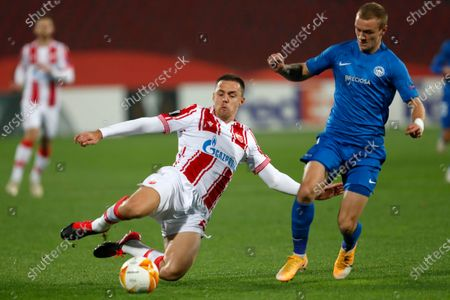 Red Star's Milan Rodic, left, and Slovan Liberec's Jan Matousek challenge for the ball during the Europa League group L soccer match between Red Star and Slovan Liberec at the Rajko Mitic Stadium in Belgrade, Serbia