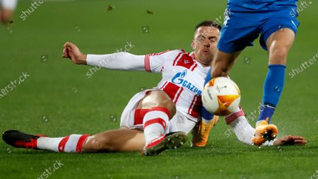 Red Star's Milan Rodic, bottom, and Slovan Liberec's Jan Matousek challenge for the ball during the Europa League group L soccer match between Red Star and Slovan Liberec at the Rajko Mitic Stadium in Belgrade, Serbia