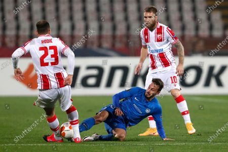 Red Star's Milan Rodic, from left, Slovan Liberec's Jakub Hromada and Red Star's Aleksandar Katai challenge for the ball during the Europa League group L soccer match between Red Star and Slovan Liberec at the Rajko Mitic Stadium in Belgrade, Serbia