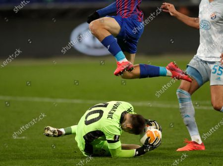 Dinamo Zagreb's goalkeeper Dominik Livakovic makes a save during the Europa League Group K soccer match between CSKA Moscow and Dinamo Zagreb at CSKA Arena in Moscow, Russia