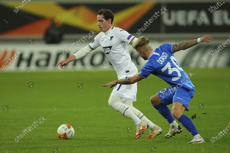 Stock Image of Hoffenheim's Sebastian Rudy, left, vies for the ball with Gent's Niklas Dorsch during the Europa League Group L soccer match between Gent and Hoffenheim at the KAA Gent stadium in Gent, Belgium