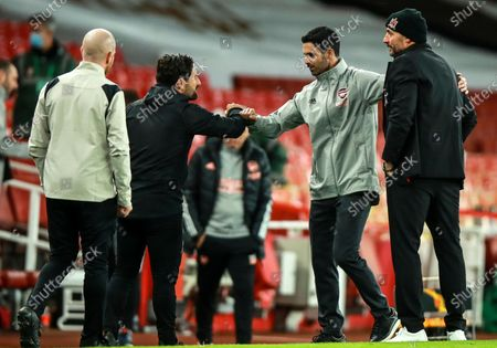 Arsenal vs Dundalk. Arsenal manager Mikel Arteta with Dundalk manager Filippo Giovagnoli and assistant coach Giuseppe Rossi after the game
