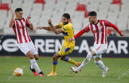 Sivasspor's Faycal Fajr, left, and Robin Yalcin, right, try to stop Maccabi Tel Aviv's Ofir Davidzada, center, during the Europa League Group I soccer match between Sivasspor and Maccabi Tel Aviv, in Sivas, Turkey