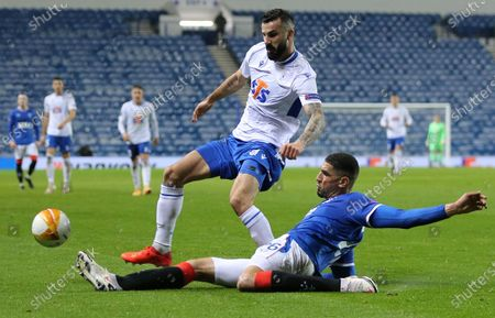 Stock Photo of Leon Balogun (R) of Ramgers in action against Mikael Ishak of Lech Poznan attempts a shot on goal during the UEFA Europa League group D match between Glasgow Rangers and Lech Poznan in Glasgow, Britain, 29 October 2020.
