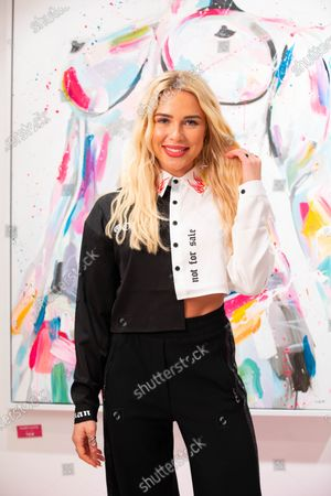 Gabrielle Allen arrives at a private preview of viral artist Sophie Tea's Send More Nudes exhibition at her Carnaby gallery, London.