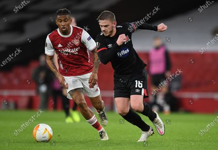 Reiss Nelson (L) of Arsenal in action against Sean Murray of Dundalk during the UEFA Europa League group B match between Arsenal London and Dundalk in London, Britain, 29 October 2020.
