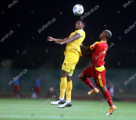 Al-Qadisiyah's player Carolus Andria (R) in action against Al-Taawoun's Hassan Kadesh (L) during the Saudi Professional League soccer match between Al-Qadisiyah and Al-Taawoun at Prince Saud Bin Jalawy Stadium, in Dammam, Saudi Arabia, 29 October 2020.