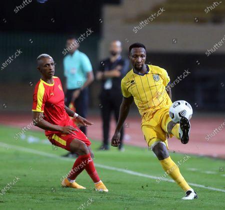 Al-Qadisiyah's player Carolus Andria (L) in action against Al-Taawoun's Hassan Kadesh (R) during the Saudi Professional League soccer match between Al-Qadisiyah and Al-Taawoun at Prince Saud Bin Jalawy Stadium, in Dammam, Saudi Arabia, 29 October 2020.