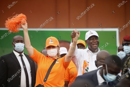 Presidential candidate Alassane Ouattara of the RHDP (Rally of Houphouetists for Democracy and Peace) holds hands with his wife Dominique Outtara during the last electoral rally ahead of the presidential election, in Abidjan, Ivory Coast, 29 October 2020. Ivory Coast will hold presidential elections on 31 October 2020.