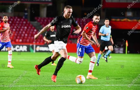 PAOK's Sverrir Ingi Ingason (C) in action during the UEFA Europa League group E soccer match between Granada CF and PAOK FC at Nuevo Los Carmenes stadium in Granada, southern Spain, 29 October 2020.