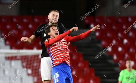 Granada's Luis Milla (R) in action against PAOK's Sverrir Ingi Ingason (L) during the UEFA Europa League group E soccer match between Granada CF and PAOK FC at Nuevo Los Carmenes stadium in Granada, southern Spain, 29 October 2020.