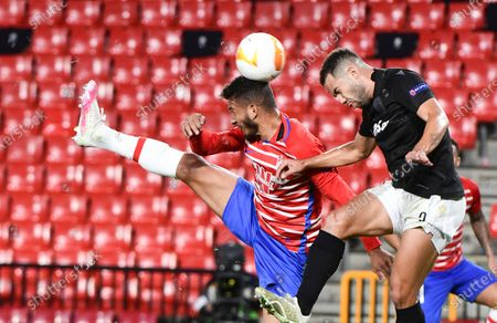 Granada's Luis Suarez (L) in action against Rodrigo Alves (R) of PAOK during the UEFA Europa League group E soccer match between Granada CF and PAOK FC at Nuevo Los Carmenes stadium in Granada, southern Spain, 29 October 2020.