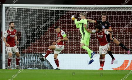 Arsenal's goalkeeper Runar Alex Runarsson takes the ball during the Europa League Group B soccer match between Arsenal and Dundalk at the Emirates Stadium in London, Thursday, Oct. 29. 2020