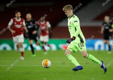 Arsenal's goalkeeper Runar Alex Runarsson kicks the ball clear during the Europa League Group B soccer match between Arsenal and Dundalk at the Emirates Stadium in London, Thursday, Oct. 29. 2020