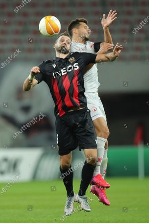 Nice's Morgan Schneiderlin goes for the ball with Hapoel Beer-Sheva's Mariano Bareiro during the Europa League Group C soccer match between OGC Nice and Hapoel Beer-Sheva at the Allianz Riviera stadium in Nice, France