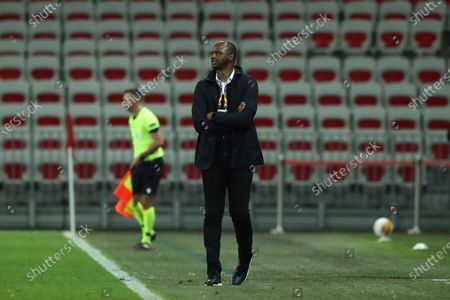 Stock Photo of Nice's head coach Patrick Vieira looks on during the Europa League Group C soccer match between OGC Nice and Hapoel Beer-Sheva at the Allianz Riviera stadium in Nice, France