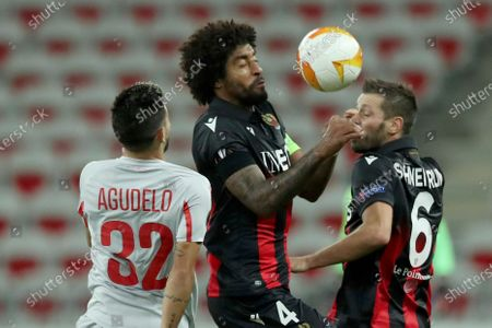 Hapoel Beer-Sheva's Jonathan Agudelo, left, vies for the ball with Nice's Dante and Nice's Morgan Schneiderlin during the Europa League Group C soccer match between OGC Nice and Hapoel Beer-Sheva at the Allianz Riviera stadium in Nice, France