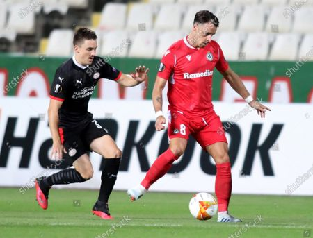 Vitor Gomes (R) of Omonia in action against Ryan Thomas (L) of PSV during the UEFA Europa League group E soccer match between Omonia Nicosia and PSV Eindhoven in Nicosia, Cyprus, 29 October 2020.