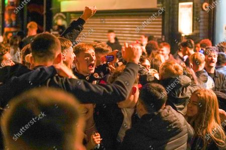 Large crowds of people partying and dancing after the 10pm curfew in the city centre before new restrictions come into force in Nottingham. The county of Nottinghamshire will enter into Tier 3 ,from 00:01 am on Friday 30 October.