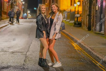 Revellers pose for a picture as they enjoy a night out in the city centre before new restrictions come into force in Nottingham. The county of Nottinghamshire will enter into Tier 3 ,from 00:01 am on Friday 30 October.