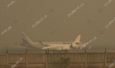 Aircraft parked on a taxiway amid heavy haze in the morning at Indira Gandhi International (IGI) Airport, on October 29, 2020 in New Delhi, India.
